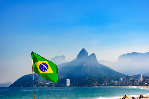 Brazilian flag at Ipanema beach stock photo