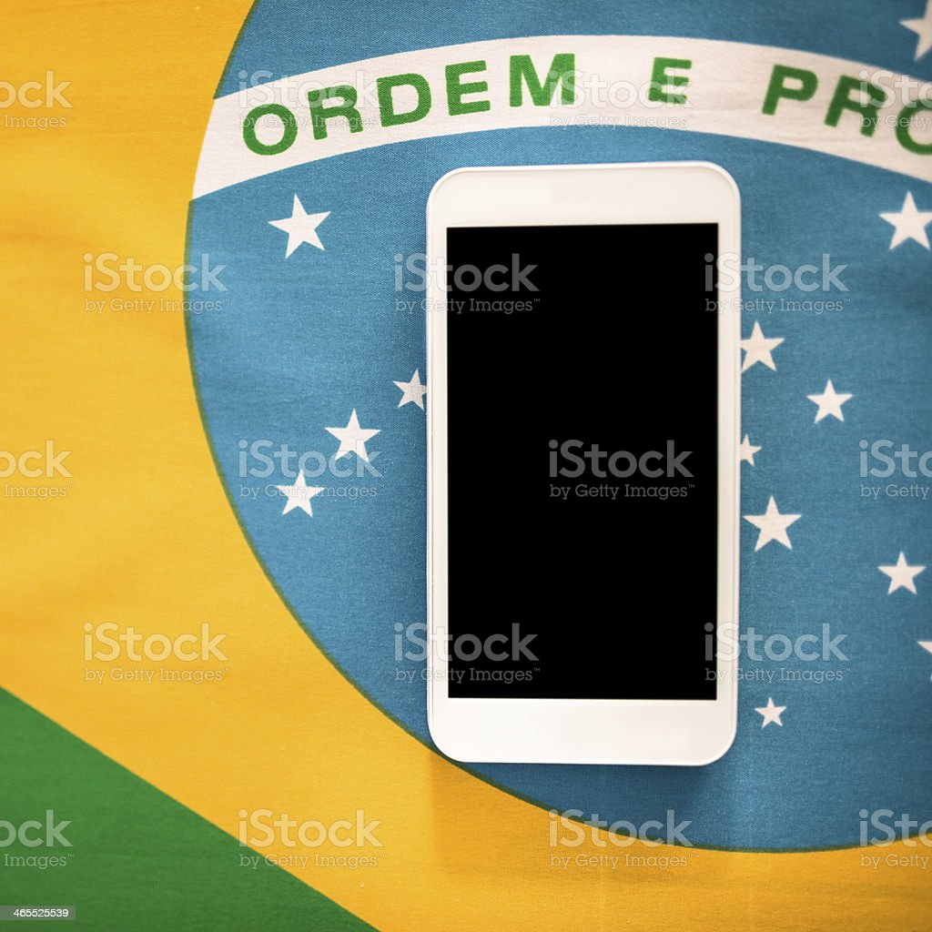 brazilian flag background with smartphone royalty-free stock photo