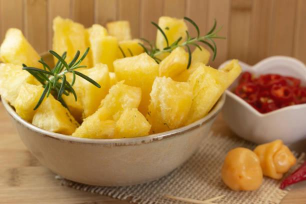 Brazilian food mandioca amarela. Yellow cassava root. stock photo