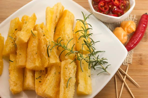 Brazilian food mandioca frita. Deep fried cassava root. stock photo