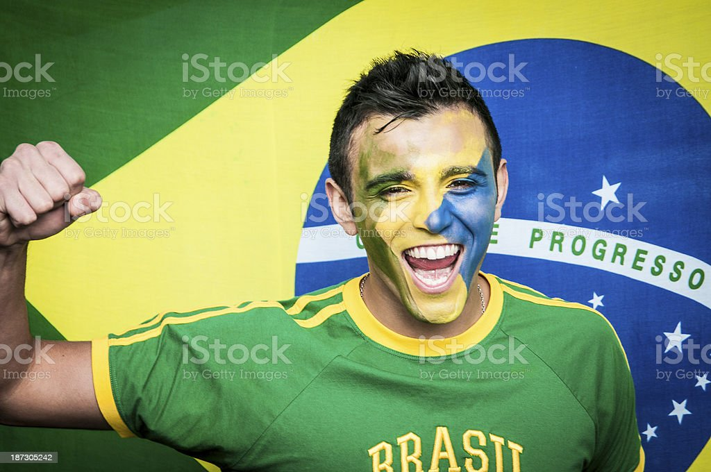 Brazilian Football Fan standing in front of National Flag stock photo