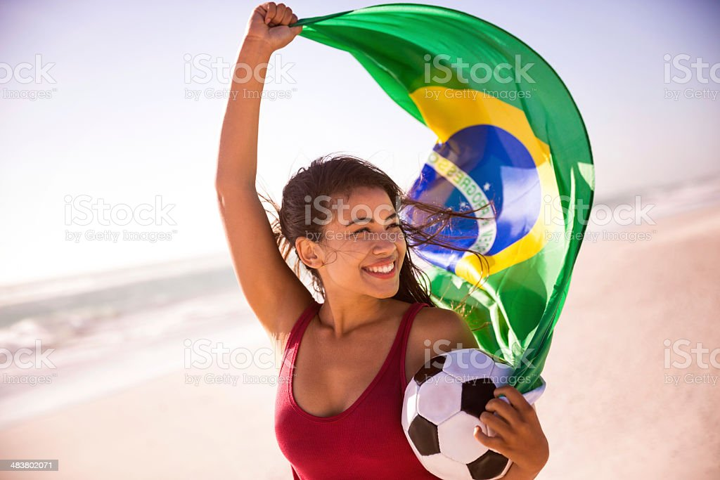 Brazilian football fan with flag royalty-free stock photo