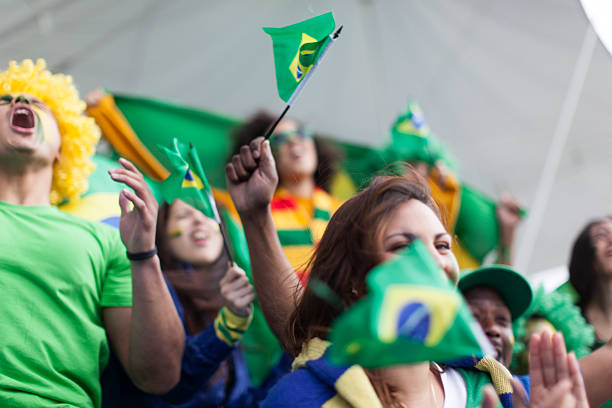Brazilian football fans shouting and screaming. stock photo