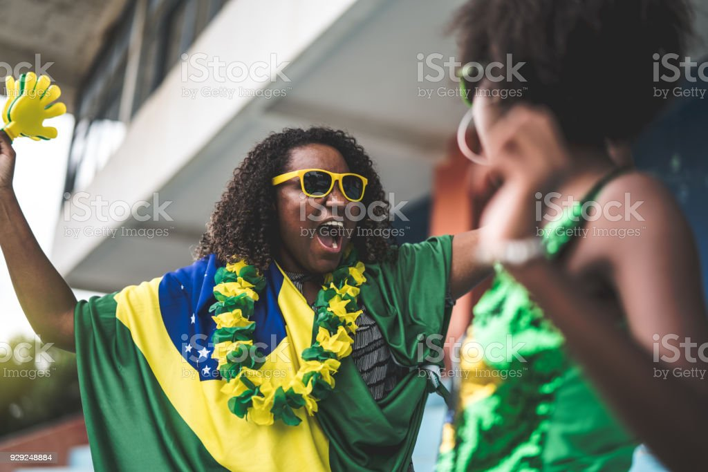 Brazilian friends watching a soccer game stock photo
