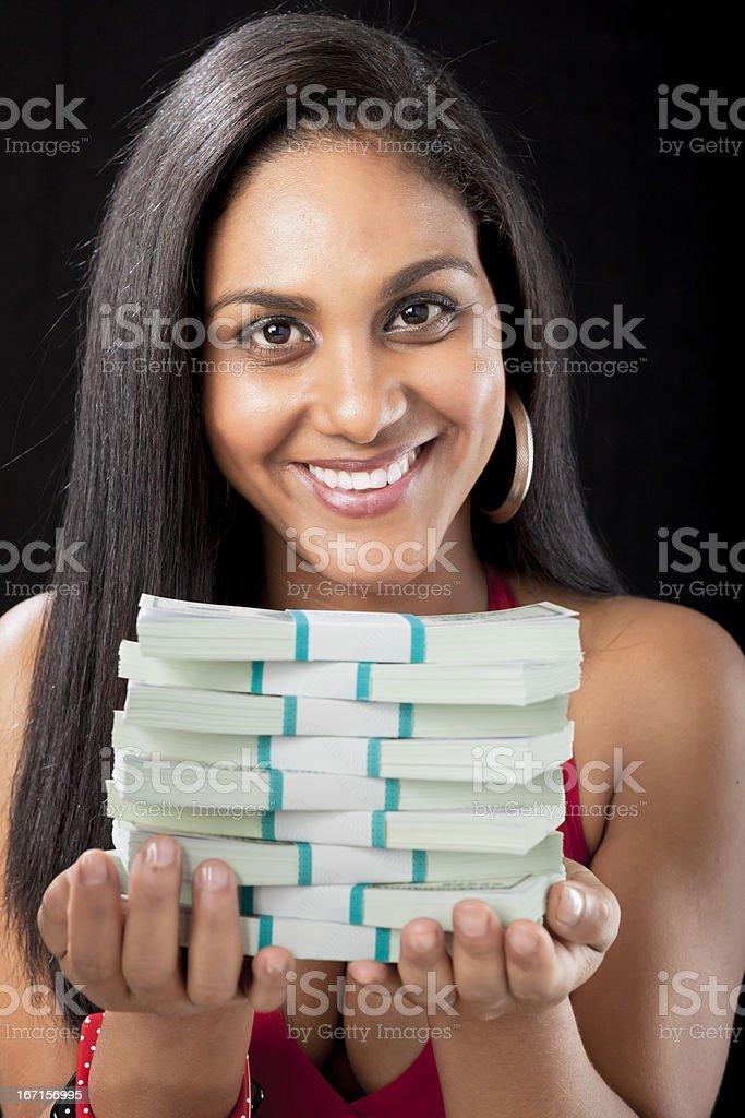 Brazilian girl isolated on black offering many dollar bills royalty-free stock photo