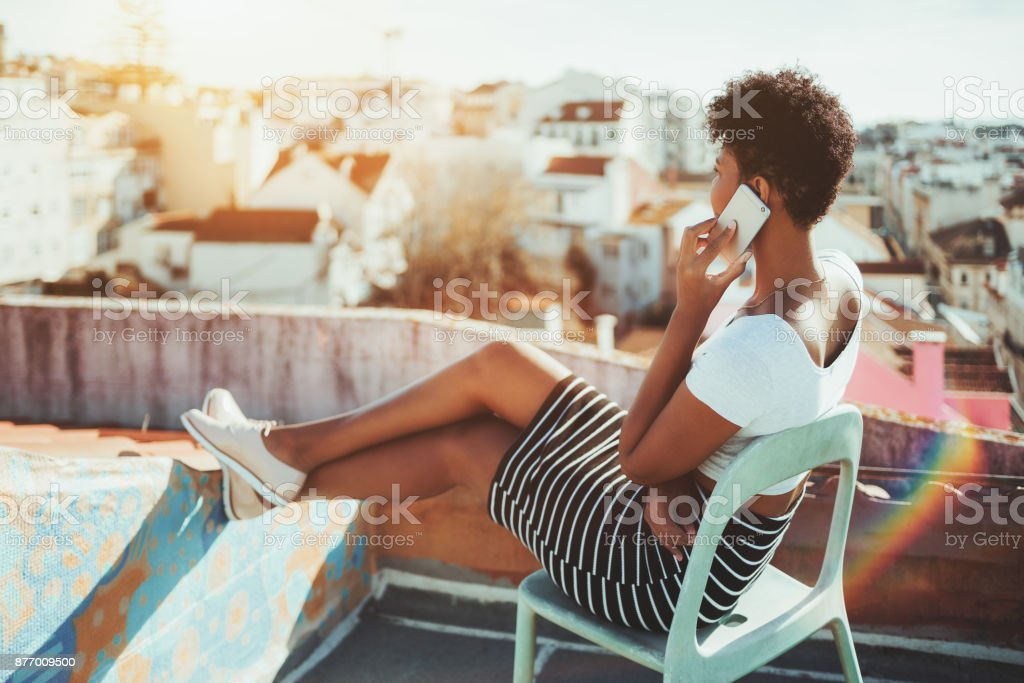 Brazilian girl on the balcony talking on the phone