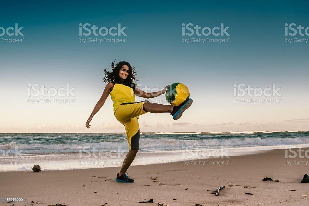 brazilian girl playing beach soccer sundown stock photo