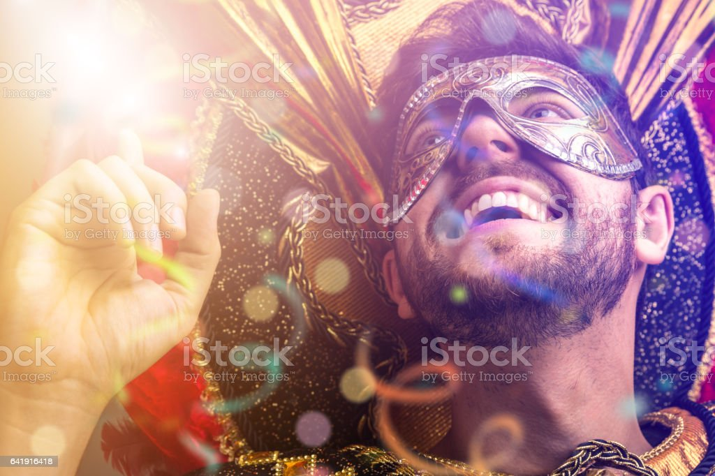 Brazilian guy wearing carnival costume stock photo