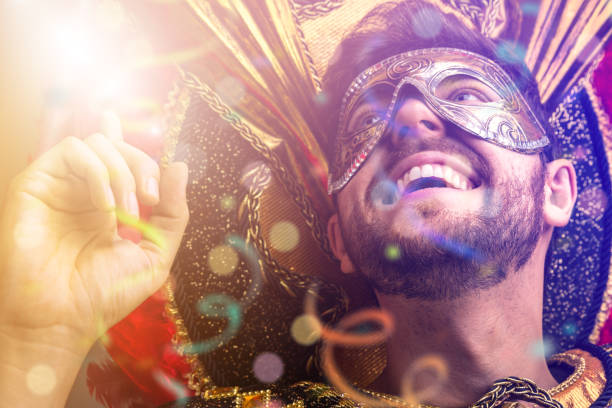 brazilian guy wearing carnival costume - school fete stock photos and pictures