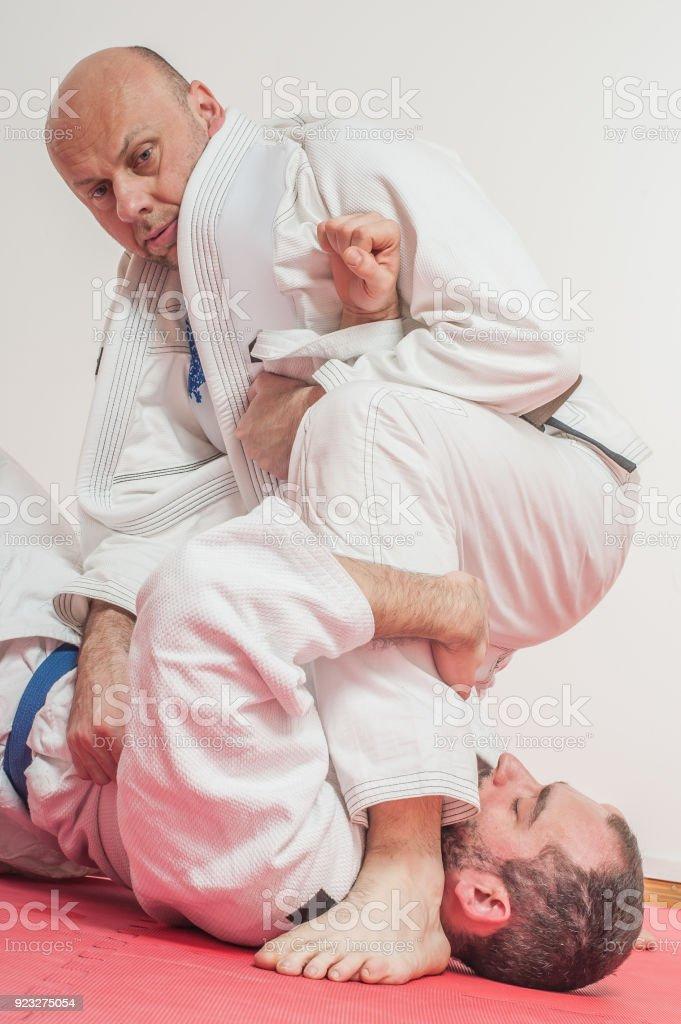 BJJ Brazilian jiu-jitsu training demonstration in traditional kimono stock photo
