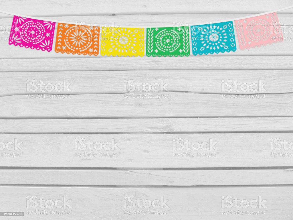 Brazilian june party, festa junina mockup. Birthday decorative scene. String of handmade cut paper flags. Party decoration. White wooden background, empty space. Top view stock photo