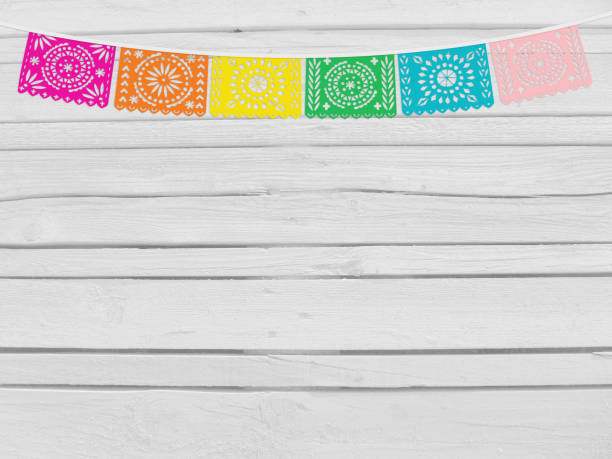 Brazilian june party, festa junina mockup. Birthday decorative scene. String of handmade cut paper flags. Party decoration. White wooden background, empty space. Top view - foto stock