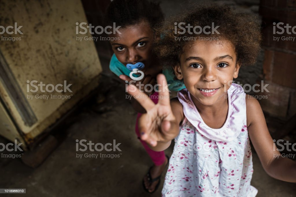 Brazilian little girl making two or V sign with her fingers stock photo