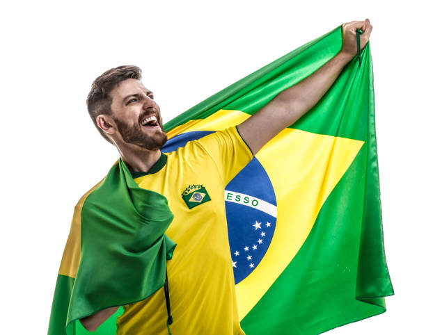 Brazilian male athlete / fan celebrating on white background stock photo