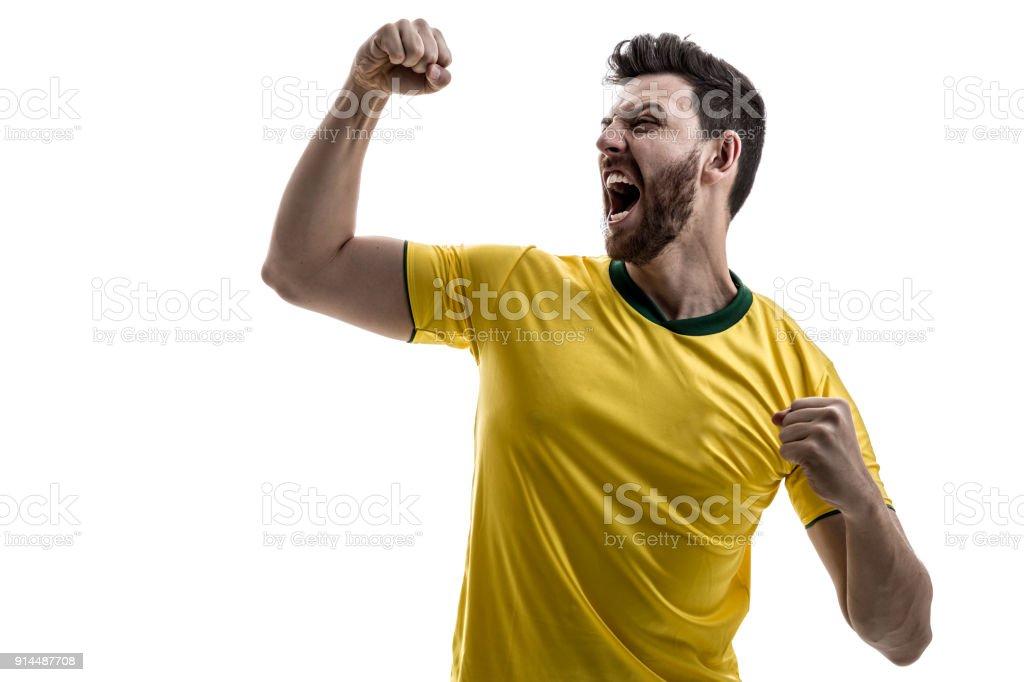 Atleta masculino brasileira / ventilador comemorando em fundo branco - foto de acervo