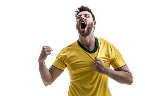 brazilian male athlete / fan celebrating on white background - fan enthusiast stock photos and pictures