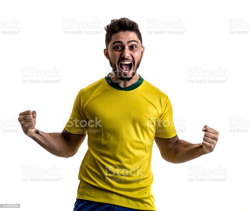 Fã brasileiro masculino / atleta celebrando em fundo branco - foto de acervo
