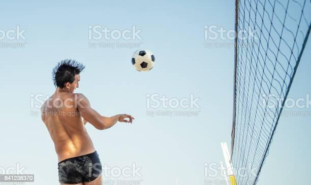 Brazilian man heading soccerball over volleyball net in rio picture id841238370?b=1&k=6&m=841238370&s=612x612&h= hqtlrjghmx0zzosxcrhrynwdumude0cxdqa9vifj0u=