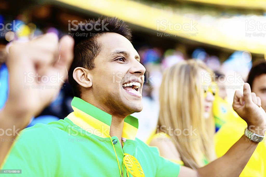 Brazilian man is delighted with his team's play royalty-free stock photo