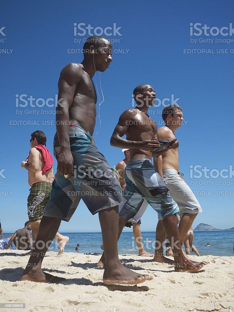 Brazilian Men Walk Together on Beach Rio de Janeiro Brazil royalty-free stock photo