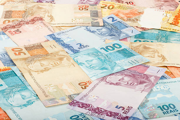 Brazilian money. A lot of new real notes. Brazilian money. A lot of new real notes. brazilian culture stock pictures, royalty-free photos & images
