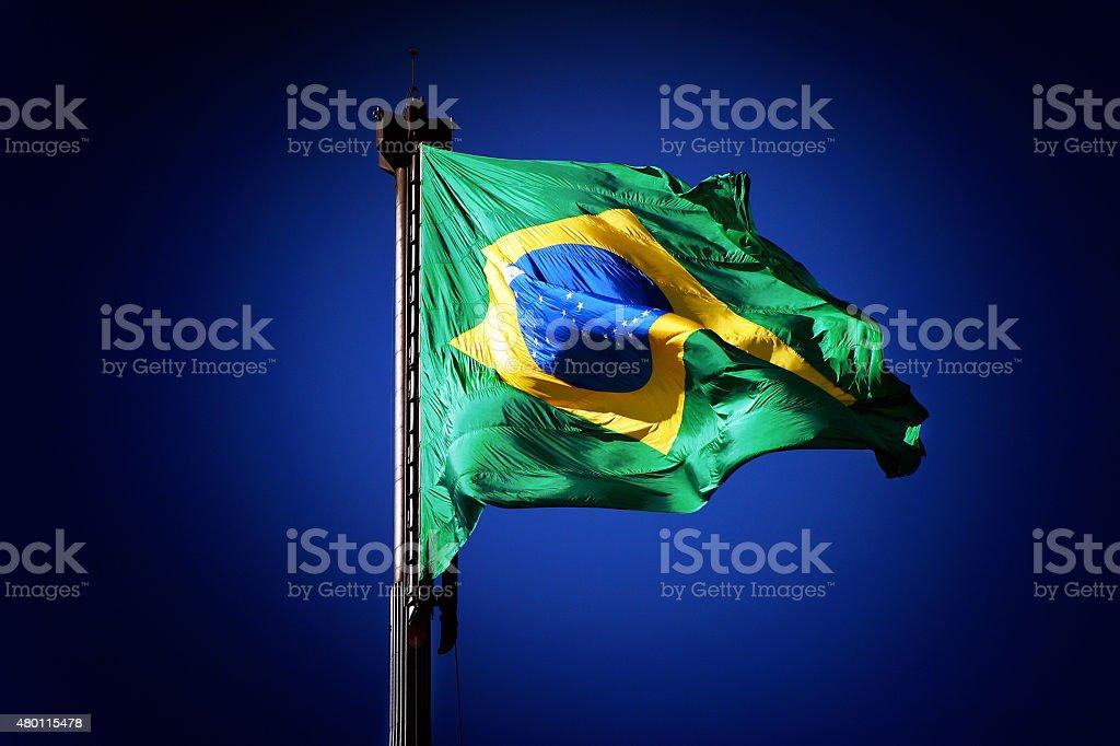 Brazilian National Flag Waving in Blue Sky stock photo