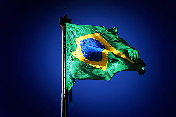 Brazilian National Flag Waving in Blue Sky stock photo