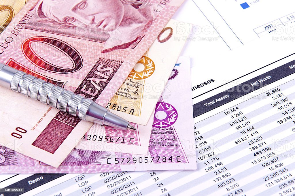 Brazilian paper money on top of a financial analysis chart  stock photo