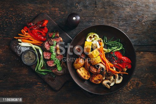 808351106istockphoto Brazilian picanha steak with fresh herb sauce and grilled vegetables 1159380615
