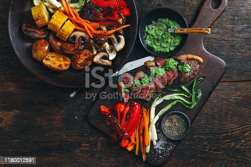 808351106istockphoto Brazilian picanha steak with fresh herb sauce and grilled vegetables 1160012591