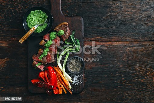 808351106istockphoto Brazilian picanha steak with fresh herb sauce and grilled vegetables 1160157756