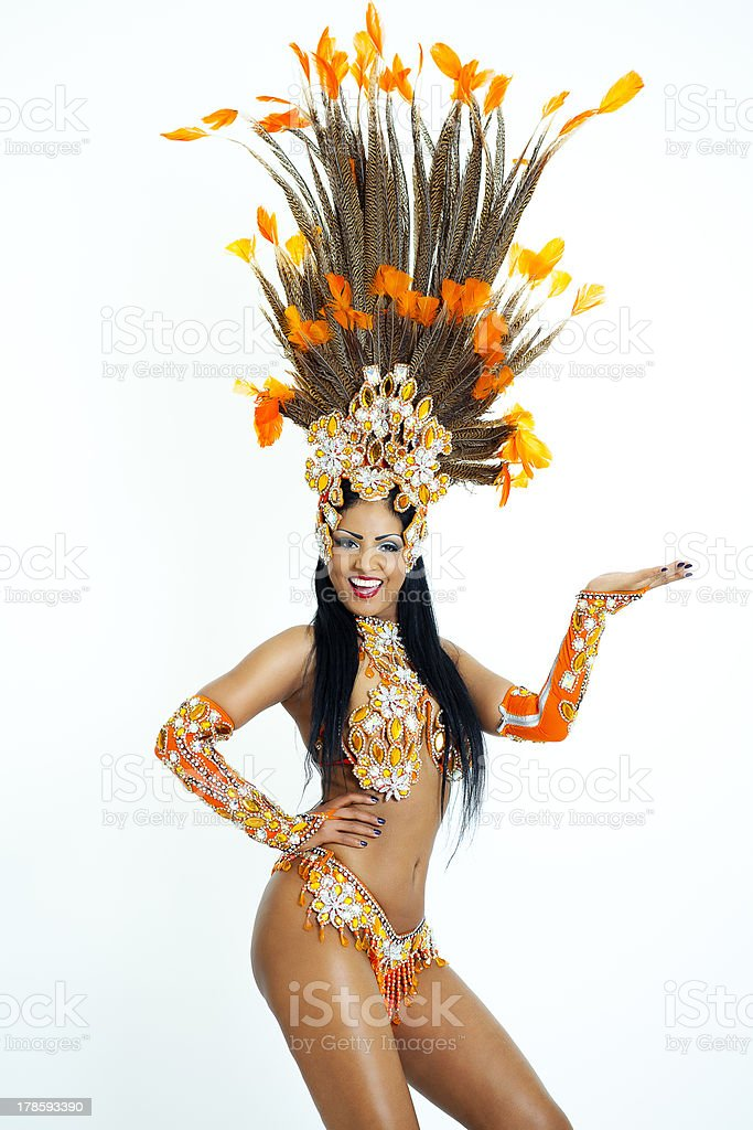 Brazilian samba dancer wearing feather headdress stock photo