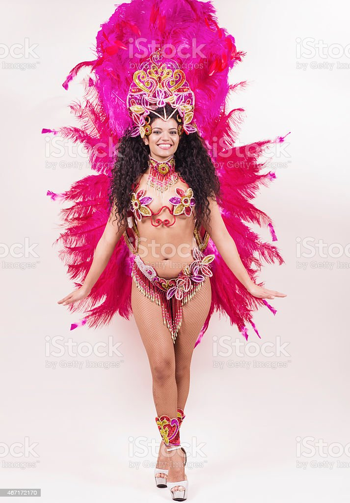 Brazilian samba dancer wearing traditional pink costume and smil stock photo