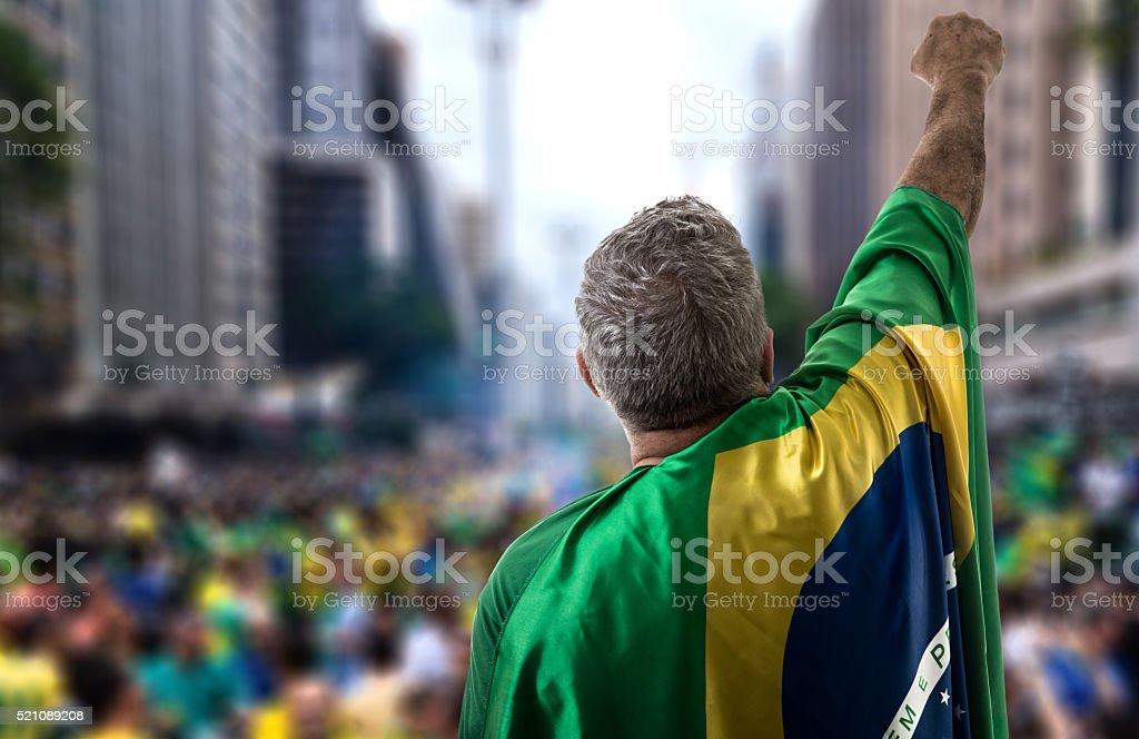 Brazilian senior holding the flag in Sao Paulo stock photo