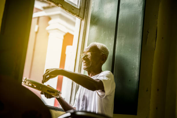 brazilian senior playing samba at home - samba imagens e fotografias de stock