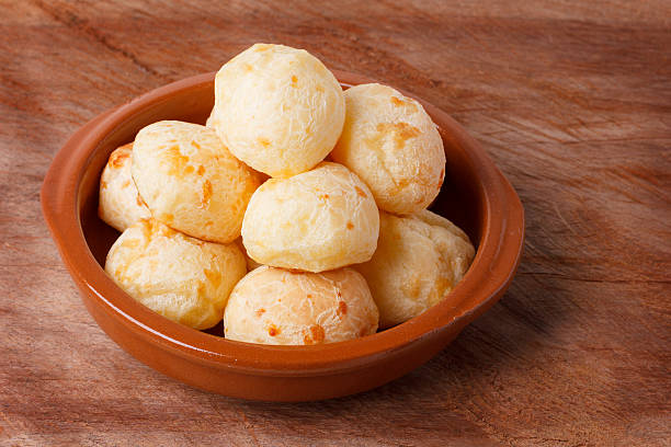 Brazilian snack cheese bread (pao de queijo) in bowl stock photo