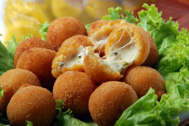 Brazilian snack with melted cheese Brazilian snack with melted cheese coxinha stock pictures, royalty-free photos & images