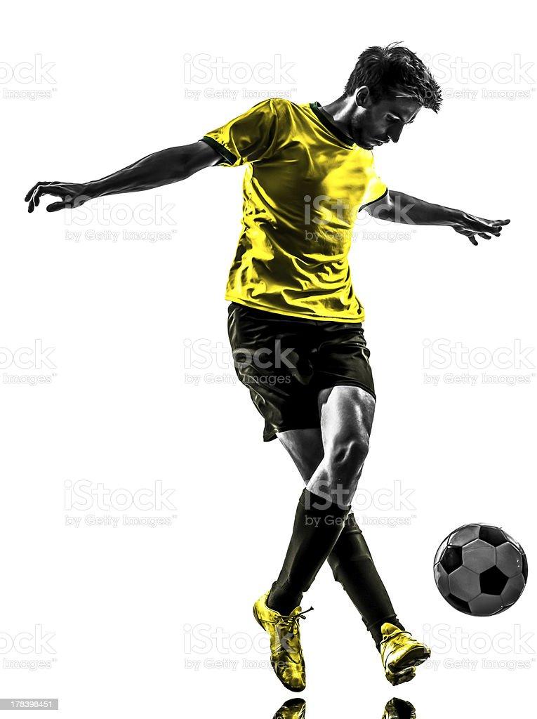 brazilian soccer football player young man dribbling silhouette stock photo