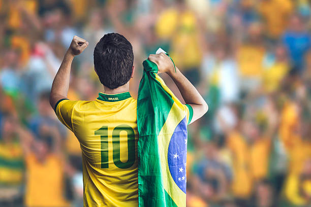 Brazilian soccer player celebrates in stadium stock photo