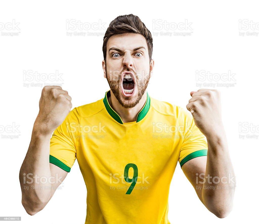 Jogador de futebol brasileiro celebra em fundo branco - foto de acervo