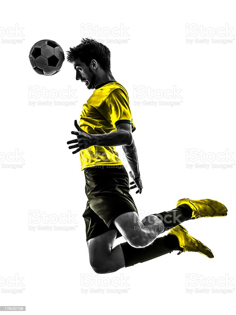 Brazilian soccer player heading the ball while jumping stock photo
