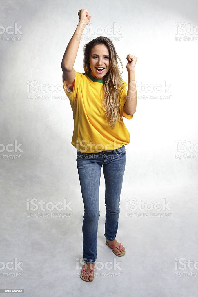 Brazilian soccer team fan | Torcedora time do Brasil royalty-free stock photo