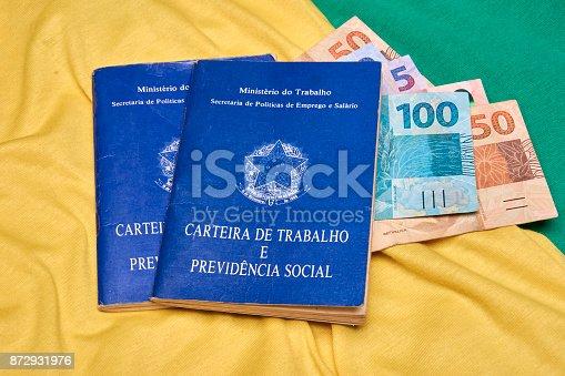 872976132 istock photo Brazilian social security document and brazilian money 872931976