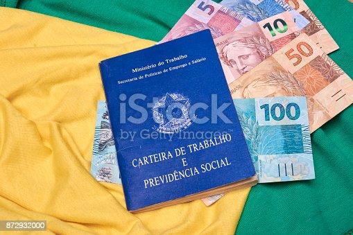 872976132 istock photo Brazilian social security document and brazilian money 872932000