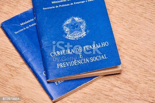 872976132 istock photo Brazilian social security document or workbook. 872973654