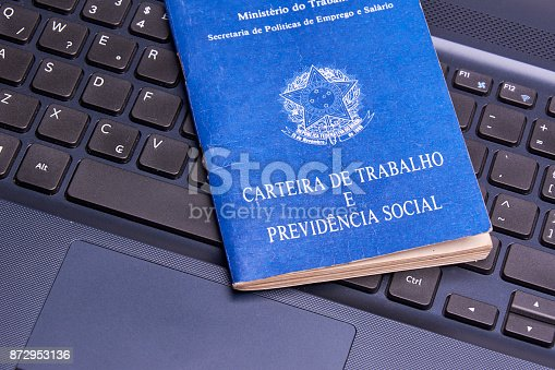 872976132 istock photo Brazilian social security document over the laptop keyboard 872953136