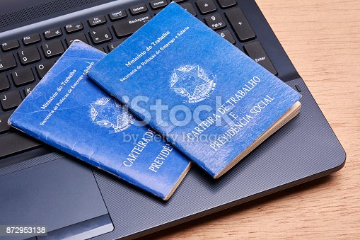 872976132 istock photo Brazilian social security document over the laptop keyboard 872953138