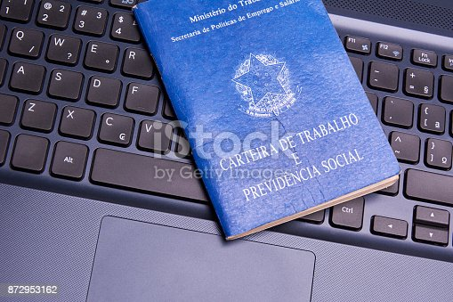 872976132 istock photo Brazilian social security document over the laptop keyboard 872953162