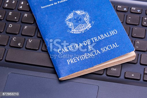 872976132 istock photo Brazilian social security document over the laptop keyboard 872953210