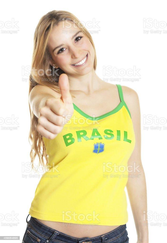 Brazilian sports fan showing thumb up royalty-free stock photo